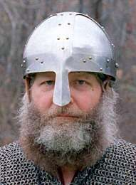 Both before and after the Viking era, helmet bowls were made from one piece of iron, hammered into shape. However, during the Viking era, helmets typically were made from several pieces of iron riveted together (right), called a spangenhelm style of helm. It's easier to make a helmet this way, requiring less labor, which may be why it was used.