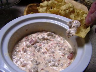 Cowboy crack with rotel, cream cheese, white corn and ground sausage. Serve with fritos - amazing!!