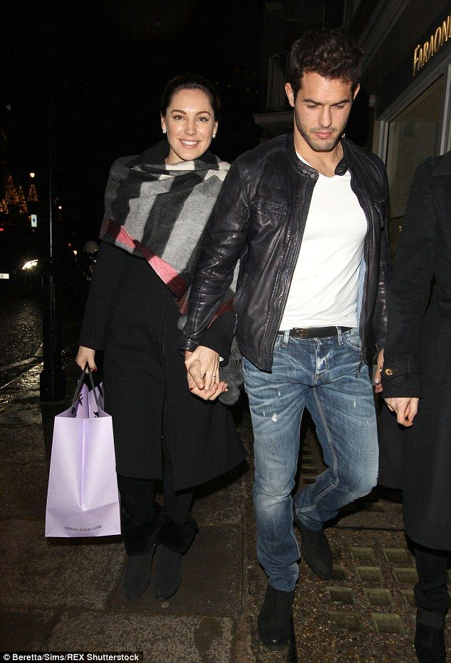 Winter wonderland: Kelly Brook looked more than loved up with her current beau Jeremy Pari...