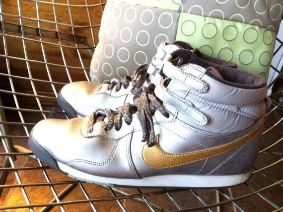 SOLD! Silver and Gold Nike hi tops US Women's size 10 via Etsy. #nike #hitops
