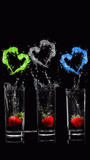 Strawberries in Glasses Flowing Into Colored Hearts