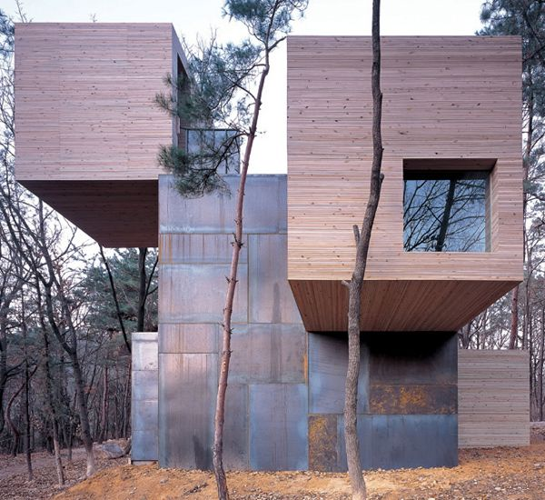 Designed by Finish architect Sami Rintala as part of the Home Design for Anyang Public Art Project, this modern wood and steel house design graces a treed hilltop in Seoul, Korea.