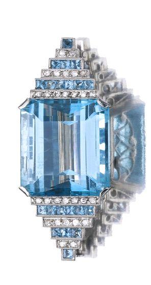AQUAMARINE AND DIAMOND BROOCH, CIRCA 1935 The centre set with a step-cut aquamarine between graduated alternating lines of scissor-cut aquamarines, circular- and single-cut diamonds.