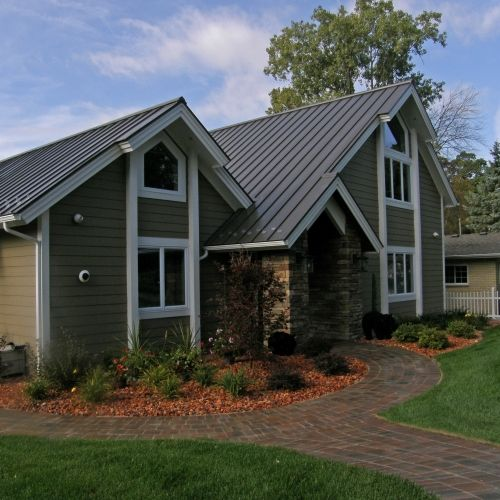 Decorative stone and plants achieve a low maintenance landscaping design.