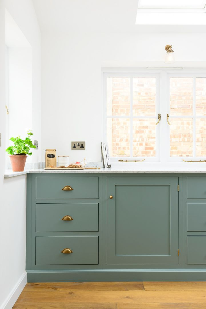The beautiful Carrara marble worktop works perfectly with deVOL's light and fresh 'Trinity Blue' Shaker cabinets; simply perfect
