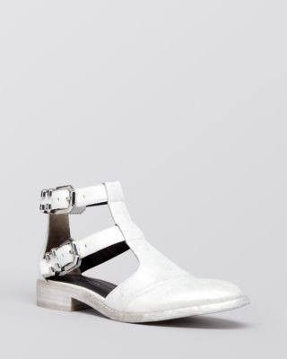Leather upper, leather lining, leather sole. Imported. Round toe; buckled ankle straps
