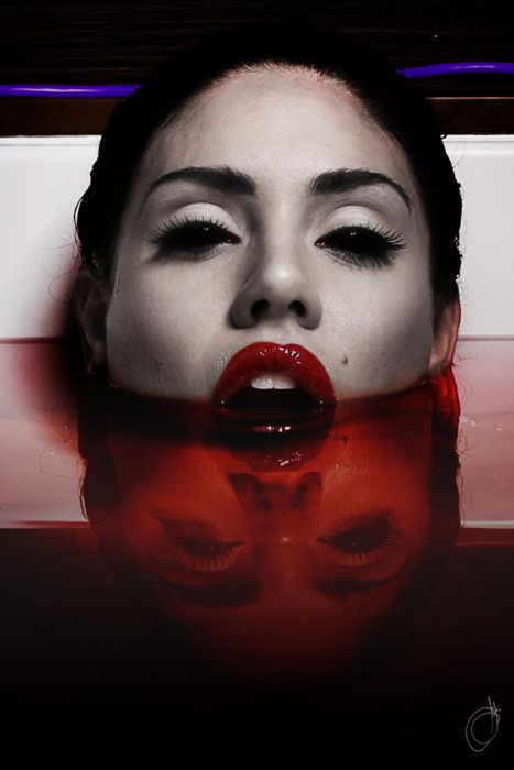 I love the simplistic horror of her make up. Absolutely beautiful!