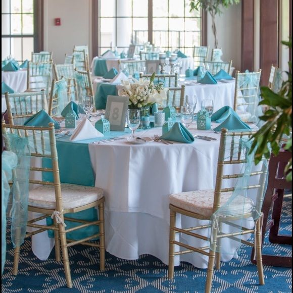 """I'm selling most of my decorations from my Tiffany Blue & silver wedding. If interested please comment. I have: votives Card box Pen Flower girl baskets Ring bearer pillow """"I DO"""" letters Cylinder vases - SOLD LED lights - SOLD Cake stand - SOLD Picture Frames Place card holders Candles, Candle holders, candlesticks, Glass gem vase fillers Linens, napkins, chair covers, chair bows, table runners-SOLD"""