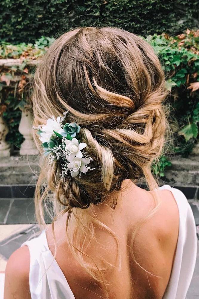 wedding hairstyles medium hair low messy side updo with white flowers cruzmakeup #weddinghairstylesupdo