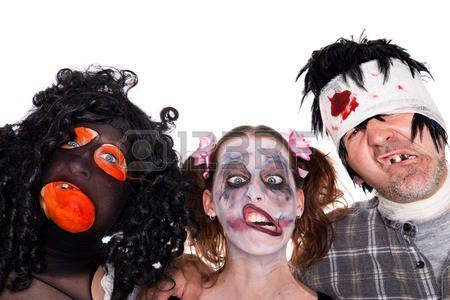 tres rostros de las criaturas de Halloween de miedo aisladas en blanco photo
