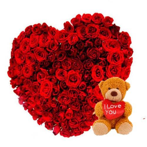 Heart shaped of 50 red roses along with 12 inch brown teddy bear.