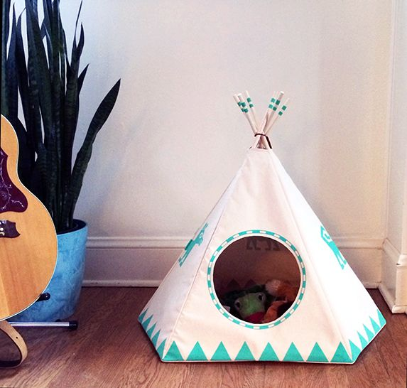 "Made to order. Please allow two weeks from purchase date to ship. I created a cat teepee originally to house our neighborhood kitty during the cold nights, and she's since made it her new home. We couldn't help passing this on to all the other little animals to enjoy!The Raven Black, Dog Teepee comes with a 1"" removable and hand washable bed, made of a soft, Blizzard Fleece material that your dog will love! The comfortable bed is perfectly fitted to the the shape of you..."