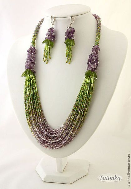 the length of necklace on the inner edge of ~ 63 cm, appearance ~ 68 cm. earrings length with fastener ~ 7.5 cm. 36- bead strands scored with a smooth transition of color from carefully selected complex mix Czech bead , comprising more than 30 colors and shades. The upper part of the necklace is made ​​up of raw amethyst and Czech leaves on pins and completed thin plaits of a mixture of beads of those same colors as in the middle of the necklace .