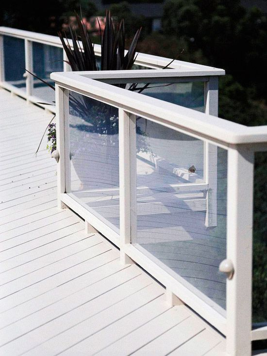 See-Through Railings...Made of tempered glass, the deck's railing preserves views while blocking ocean breezes.