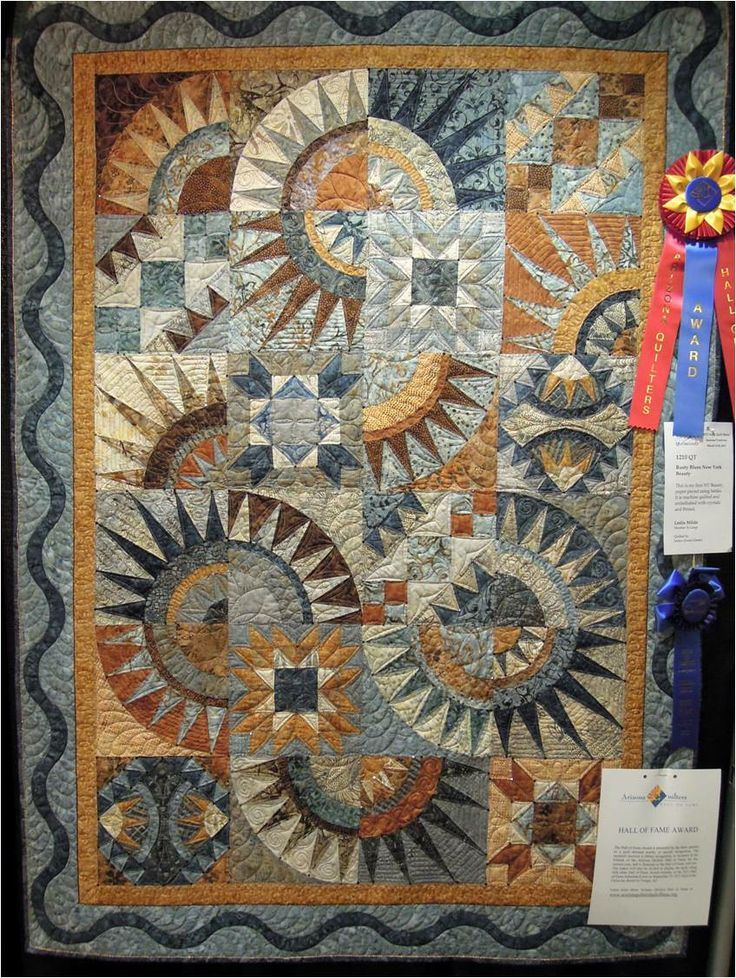 """Rusty Blues"" New York Beauty by Leslie Milde, quilted by Jessica Jones Gamez. 2013 Arizona Quilters Hall of Fame Award.  Photo by Quilt Inspiration"