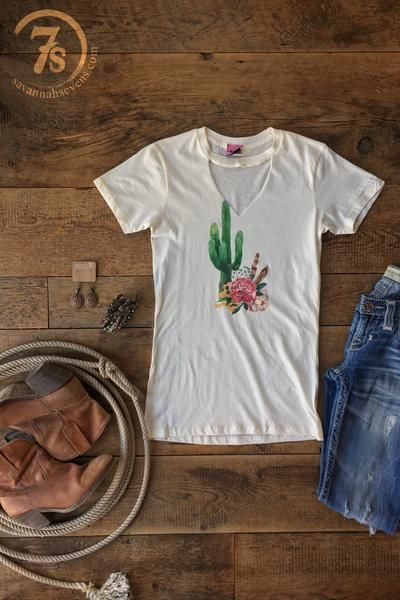 The Zona - Southwest graphic tee. Cactus, floral and feather colorful graphic. Cut out keyhole for mock neck style. Ivory soft tee. Designed to be a very slim fit so that keyhole doesn't drape open. Small fits slim on size 0/3. Size up a size or two depending the fit you want.