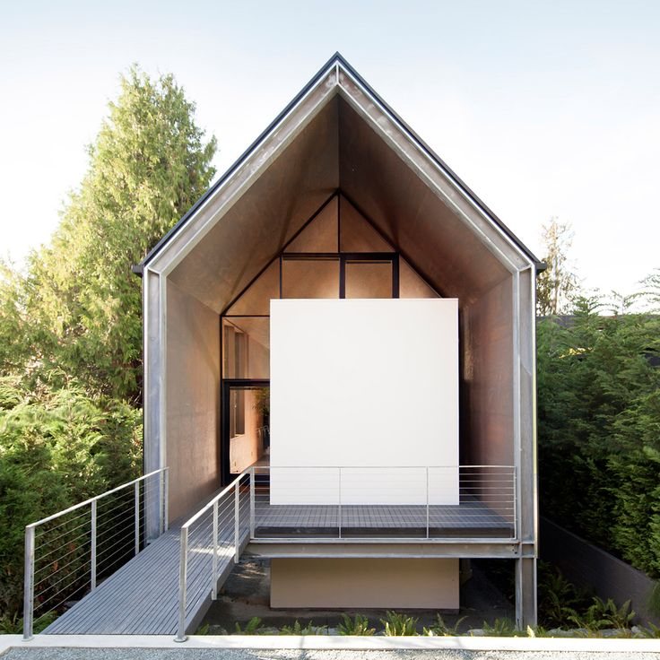 Water views from this long narrow home in West Seattle by Suyama Peterson Deguchi are strategically framed using existing trees on site.