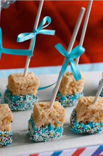 Take Rice Krispy Treats (pre-packaged) and cut in half. Take White Chocolate Velata with either blue or pink food coloring and dip. Stick in a stick, tie a bow, sprinkle. Viola! Instant Baby Shower treats!