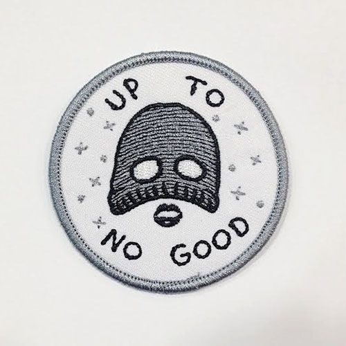 """For the trouble makers 2.5"""" embroidered patch, iron-on backing."""