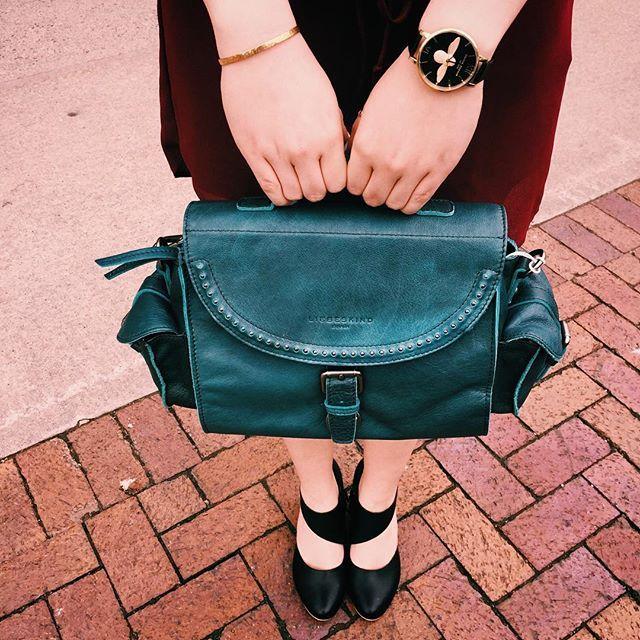 Gold embossed bee watch, turquoise handbag and geometric cutout heels