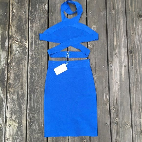 New Cobalt Blue Bandage 2 Piece Skirt set sz small New Cobalt Blue bandage skirt set. This is a size small. The top fits up to a 34C bust, skirt is pencil cut style and very flattering. Dresses