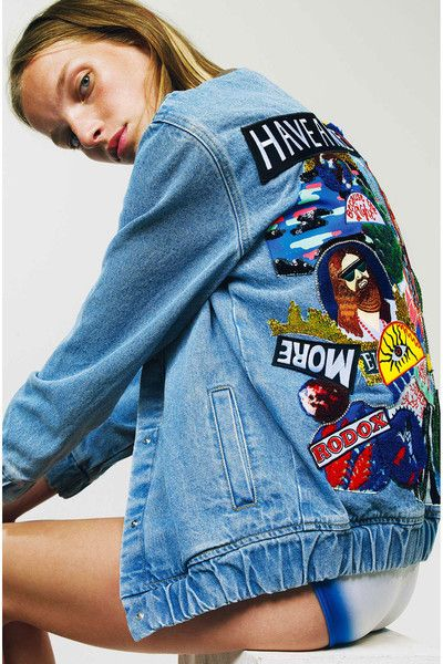 Washed-out denim bomber jacket with embroideries of sequins, badges and Swarovski Crystal at the back. Long sleeves with 2 piping pockets at the front. Aenemia