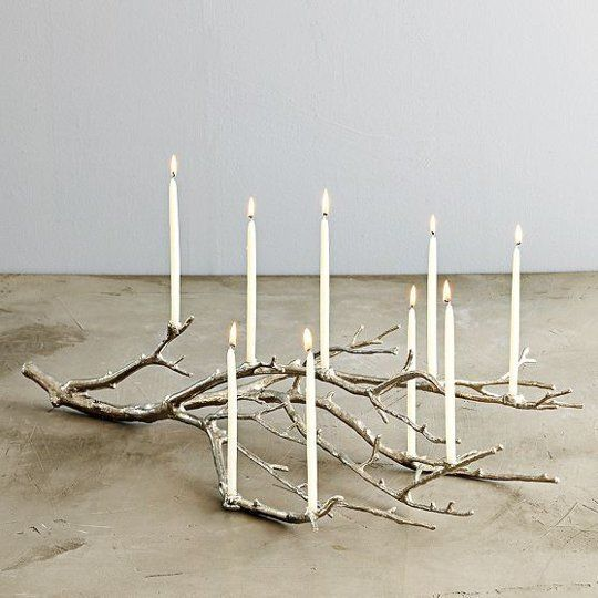 It would be fun to cover a dried out branch in resin and attach real or fake candles to it like this. Love.