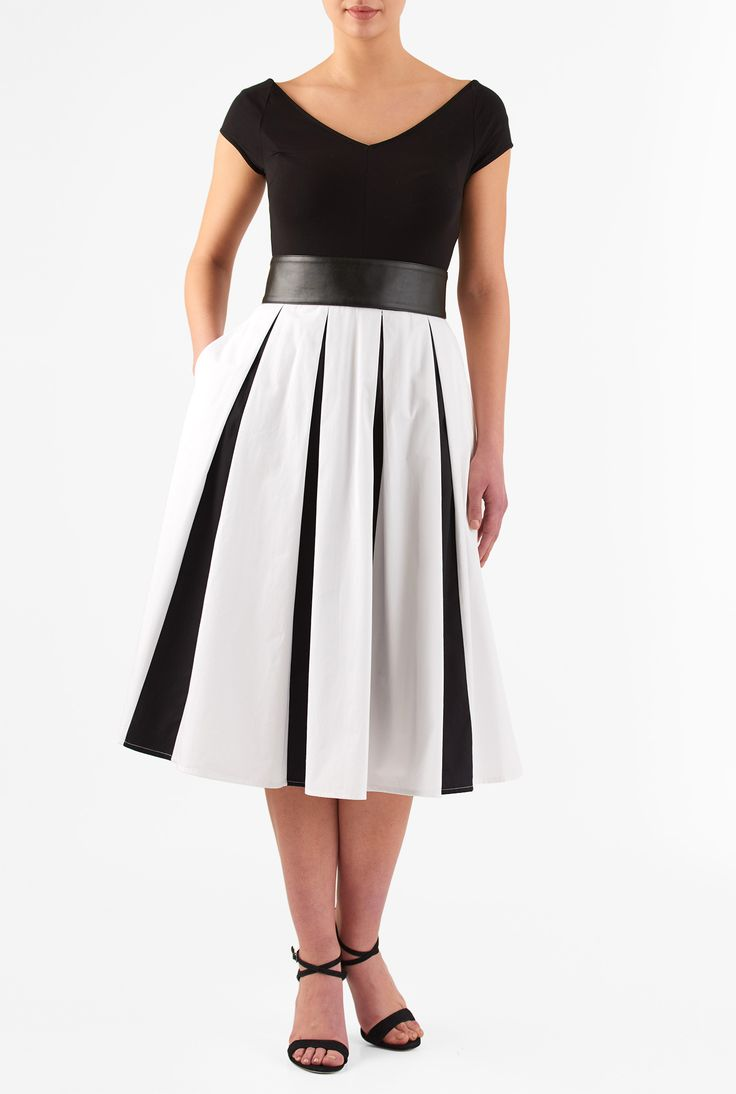Wide V-neck styling accentuates the curve-flattering fit of our two-tone mixed media dress cinched in with a wide faux leather belt with back ties.