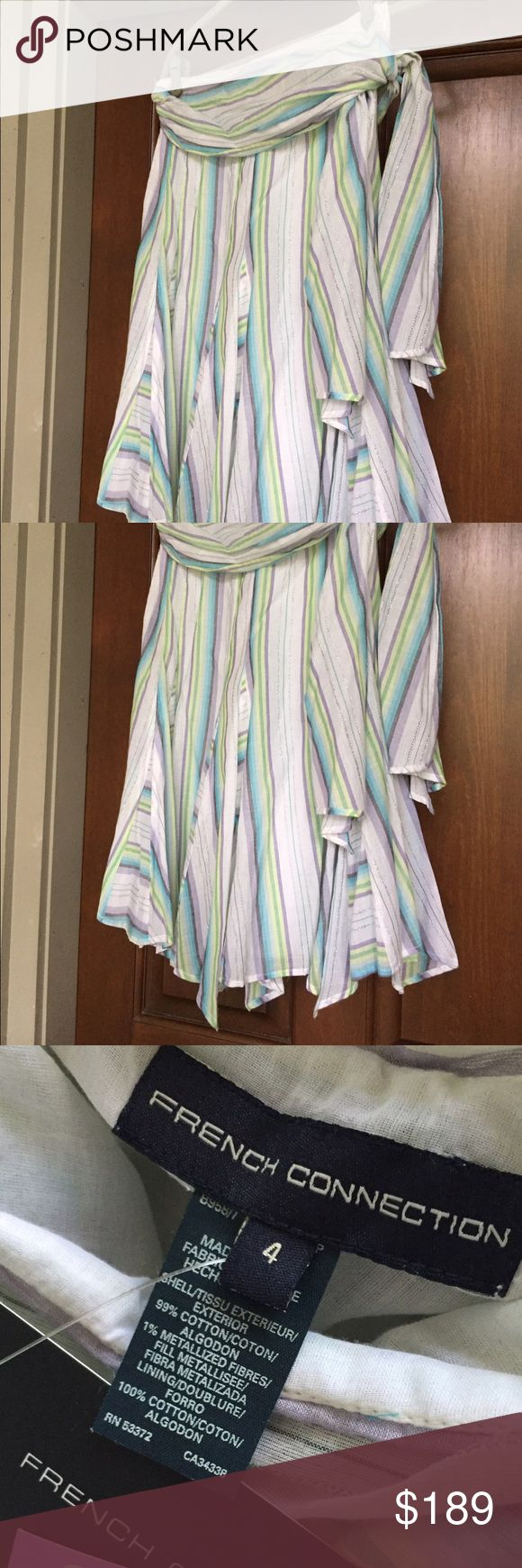 French Connection Multi Colour Skirt Size 4 Retail $228. Multicolored with purples, blues and greens and silver. Ties at waist. NWT – has never been worn but is slight staining on interior lining – positive it would come out with either normal washing or dry cleaning. French Connection Skirts Circle & Skater