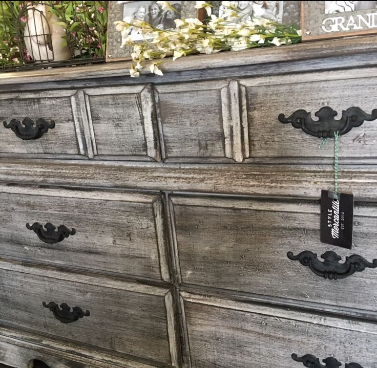 Create a barn wood style  finish with a white base coat, dry brush in some brown tones and finish with black wax brushes in the direction of the wood grain