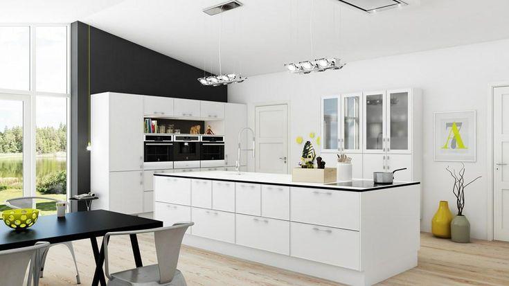 Fedt med sort bagvæg til det hvide køkken. Køkken fra Kitchn.