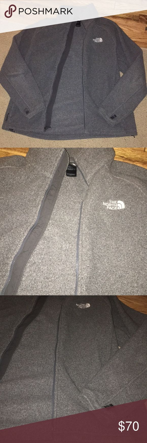 North Face Gray Fleece Zip Jacket Dark gray heather fleece. Size large. Can be men or women's, but has men's fit, meaning doesn't fit tight to body. Very very warm and light. Worn once for a short amount of time. No flaws and in perfect condition! The North Face Jackets & Coats