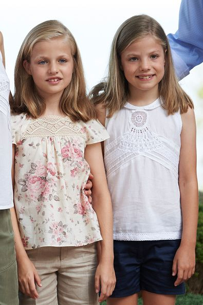 Princess Leonor of Spain (L) and Infanta Sofia of Spain (R) pose for the photographers at the Marivent Palace on August 3, 2015 in Palma de Mallorca, Spain