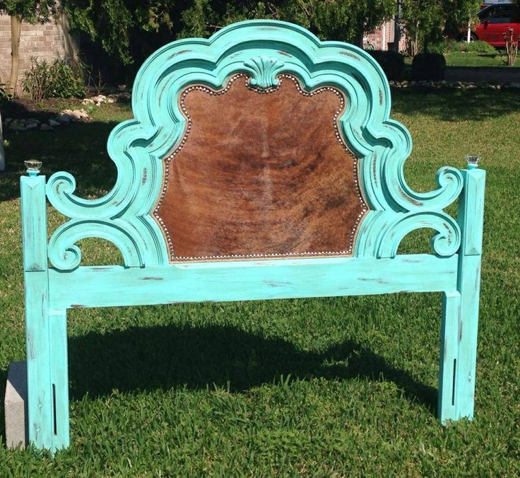 Gorgeous, unique full size distressed Turquoise headboard with cowhide insert, trimmed with rope and silver nail trim. Antique glass knobs sit on top of the bed post. Created by Antoinette's Home Decor & More, www.facebook.com/antoinetteshomedecor