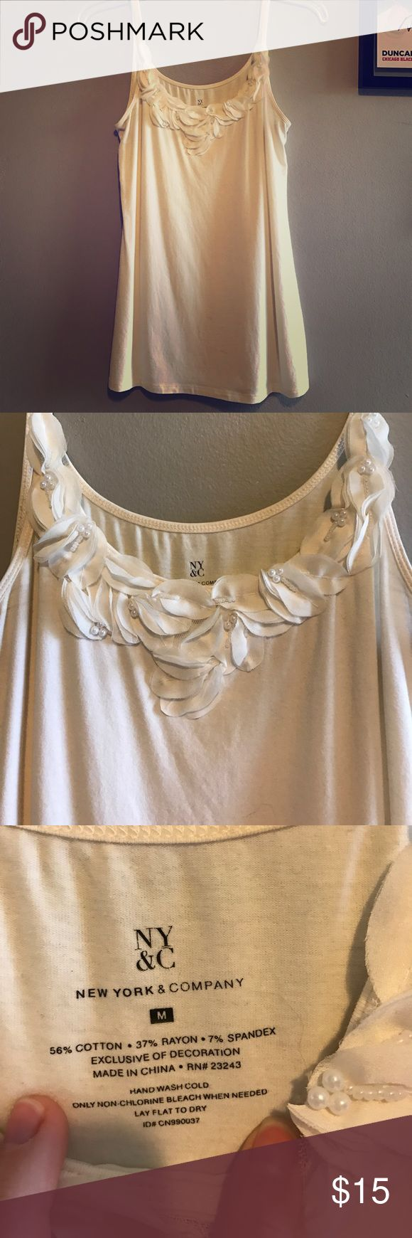 Cream cami with flower detail Crean cami from NY&Co beautiful detailing on the neckline. Size medium. Gently loved. New York & Company Tops Camisoles