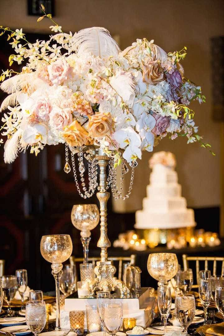 Gorgeous floral centerpiece ideas with pastel flowers, crystal beads and fluffy feathers! Love this so much! Photographer: True Photography