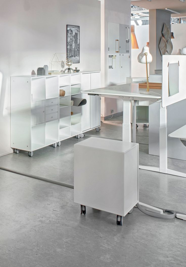 Montana at the Orgatec fair 2016. Showcasing office furniture and interiors. Shelving system, HiLow height-adjustable tables, storage modules on castors. #montana #furniture #white #office #officeinteriors #danish #design