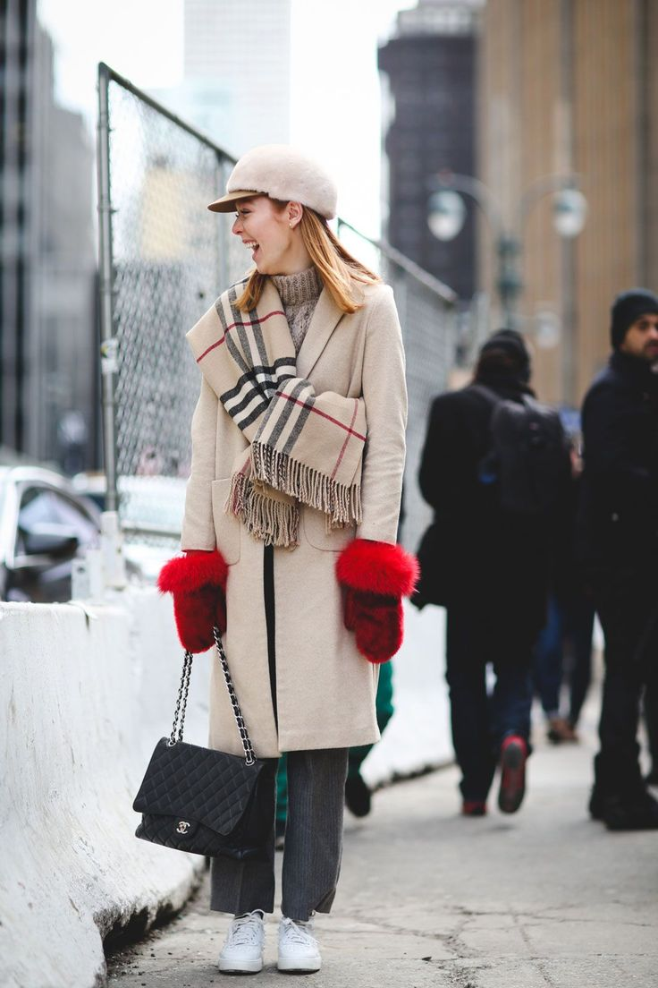 Lessons In Layering From The Streets Of New York City #refinery29 http://www.refinery29.com/2016/02/103173/ny-fashion-week-fall-winter-2016-street-style-pictures#slide-33 Get inventive with your winter accessories, since you'll likely be wearing them 24/7. Tie your scarf around something other than your neck, and grab a pair of mittens that act as a statement-maker all their own....