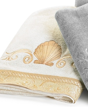 Photo Album Gallery Bath towels that can add a decorative touch to any bathroom These bath towels feature a seashell design with a scroll border Bath towel is x