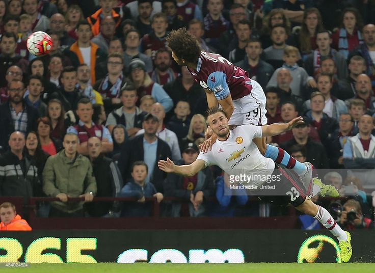 Luke Shaw of Manchester United tangles with Rudy Gestede of Aston Villa during the match