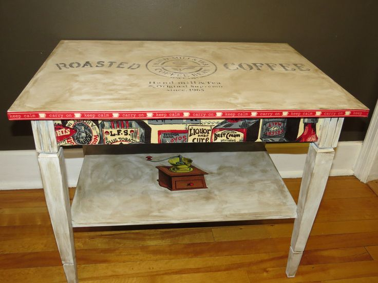 This re purposed side table has been revived as a coffee station. Coffee bean imprint on table top, second shelf has a vintage coffee grinder and the sides of the table are done in a vintage grocery theme. Great conversation piece!