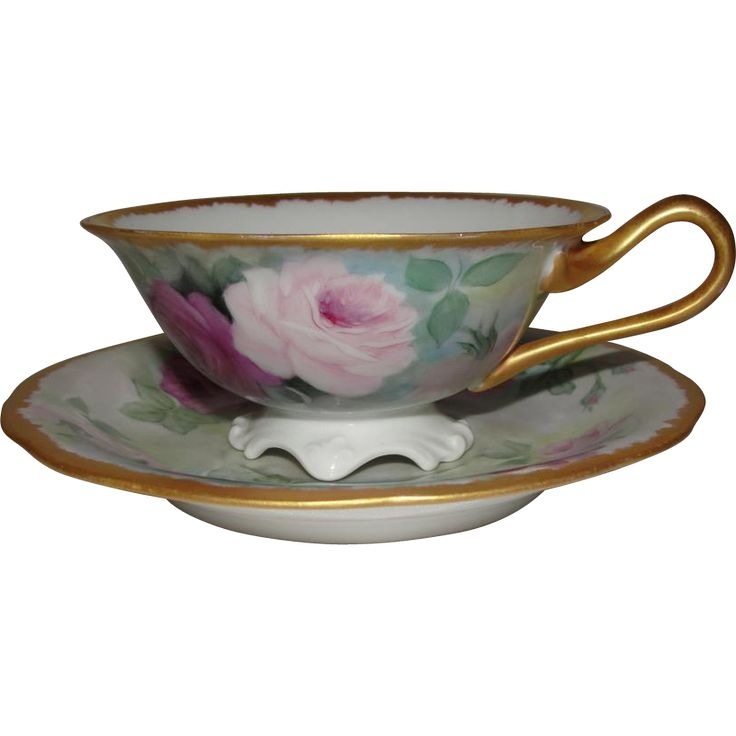 TV France Limoges Porcelain Rose Cup and Saucer. The roses are beautifully painted in shades of purple and green. The porcelain is fine, delicate and