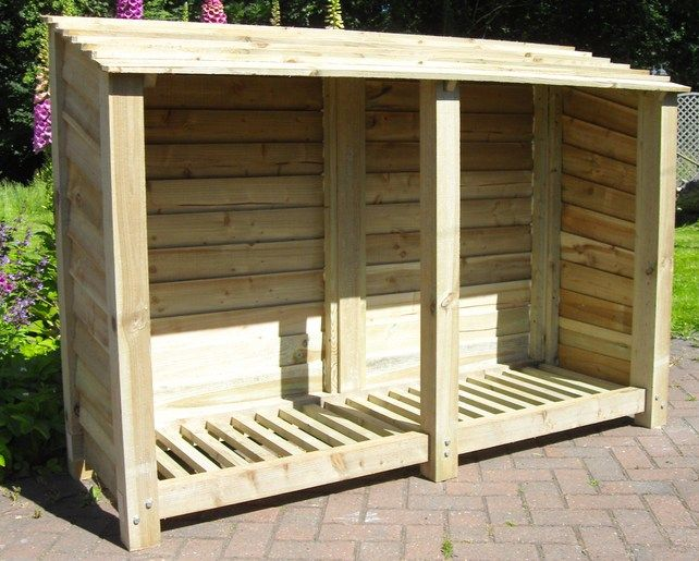 Rustic, Treated, Wooden Log Storage or perhaps could be extended and used to sell produce.