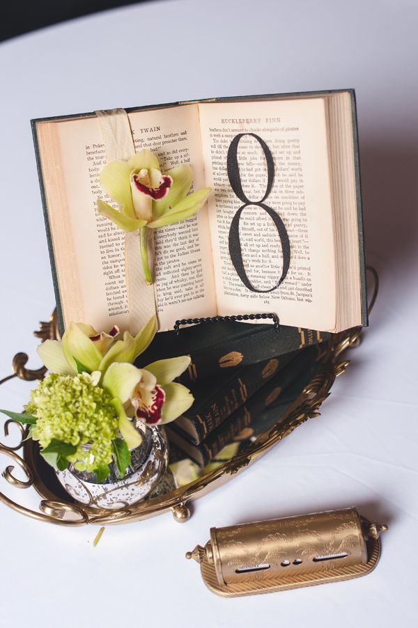 literature-inspired table numbers, photo by Katey Penton http://ruffledblog.com/notwedding-atlanta #tablenumbers #vintage #centerpieces