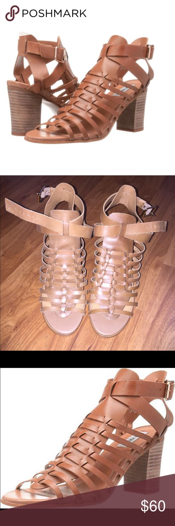 Brown strappy heels Brown gladiator like strappy heels. They are a size 6.5 but can fit 7. Leather Steve Madden Shoes Ankle Boots & Booties