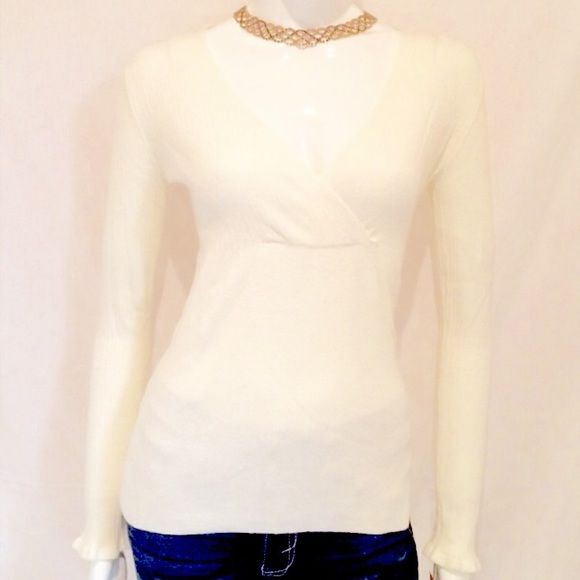 "Women's White V Neck Sweater. Women's White V Neck Sweater by Tapemeasure. 54% Cotton, 27% Lyocell, 19% Nylon. Machine Wash Warm. Armpit to armpit 16.5"", Length of sweater 24.5, Sleeve Length 24"", V Neck 10"". This is a large, but a petite large. Never Been Worn. Please note the measurements described. Tapemeasure Sweaters V-Necks"