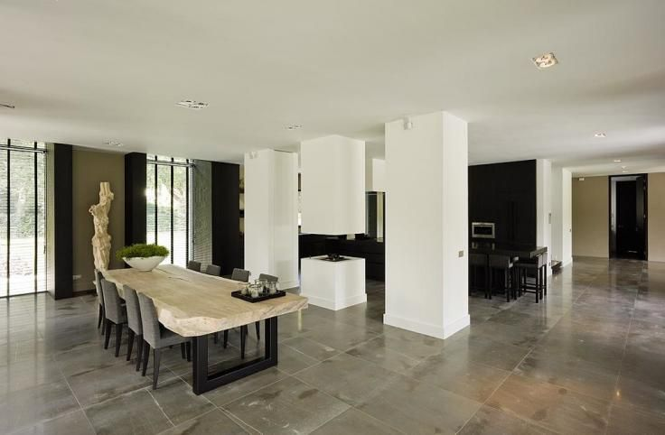 Interior by Bob Manders. I like the subtle division between the kitchen and dining room by means of columns.