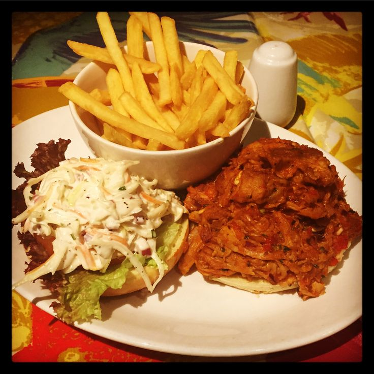 Paradise Pulled Pork: Our slow cooked shredded pork transports you to the balmy barbecues of the Deep South. the tender pork is perfectly combined with red onion, chilli & parsley in a spicy sauce and served in a brioche bun with lettuce, tomato, fries and that all important southern slaw!