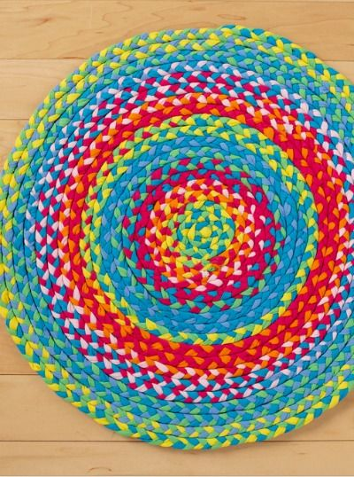 Transform old t-shirts into this cool and colorful DIY woven rug!