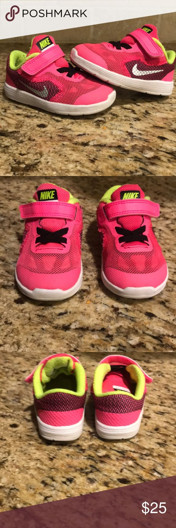 Toddler Girl Nike Revolution 3 Fantastic condition! Toddler girl Nike Revolution 3. Hot pink, silver, black, white, neon yellow. Only wear is minor piling on the inside. My daughter loved these! Freshly washed. No trades. Bundle for discount. Nike Shoes Sneakers